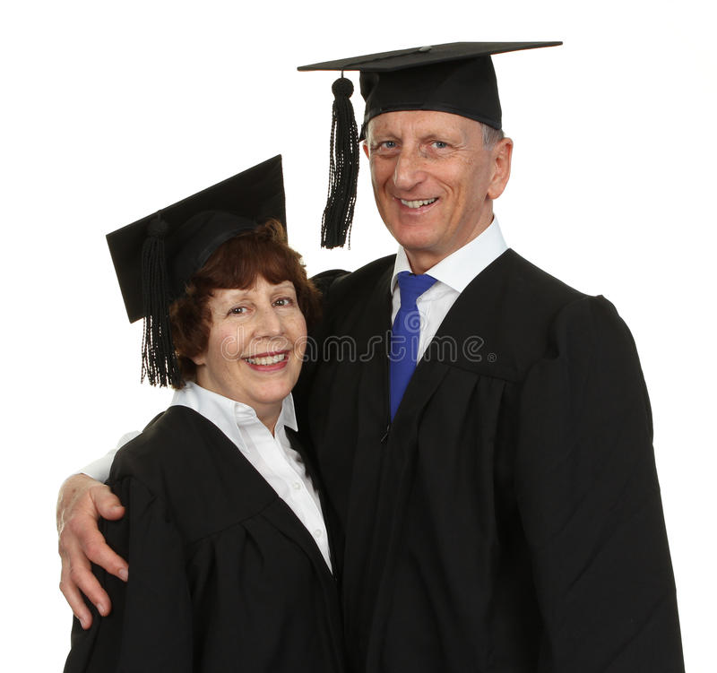 Pares felices del graduado del mayor imagen de archivo
