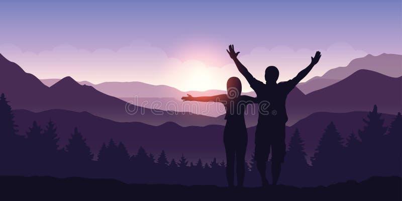 Pares felizes com os braços aumentados para apreciar a opinião da paisagem da montanha no nascer do sol ilustração stock