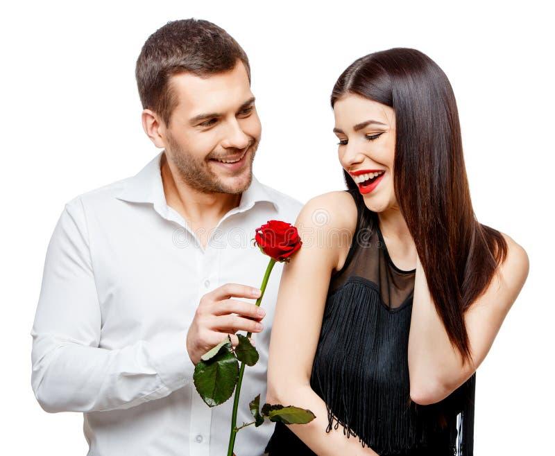 Download Pares Hermosos Jovenes Con Las Flores Aisladas En Blanco Imagen de archivo - Imagen de hombres, flores: 64210047