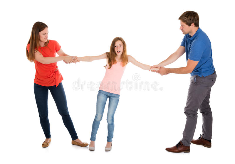 Pares infelizes que puxam sua filha em seu lado imagem de stock royalty free