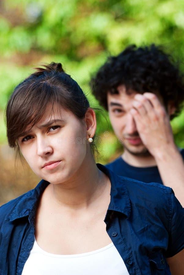 Pares jovenes después de la pelea fotografía de archivo libre de regalías