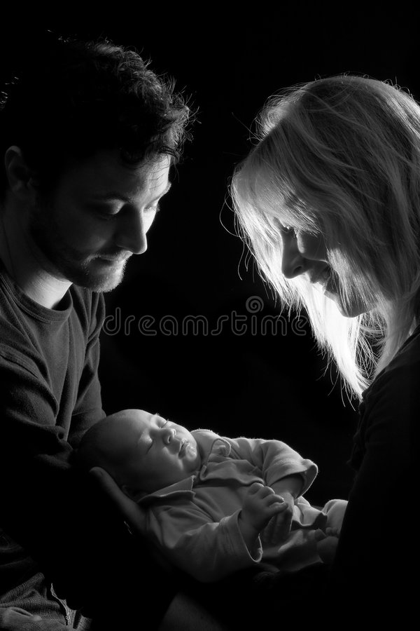 Pares loving do bebê encantador foto de stock