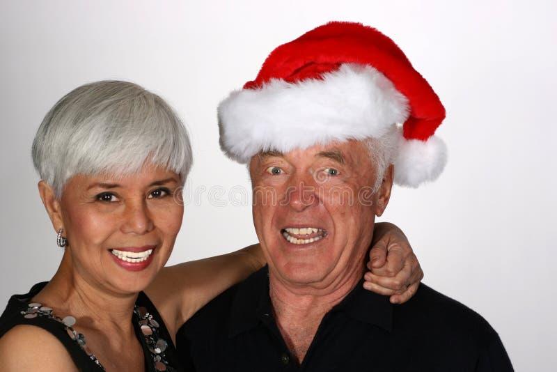 Pares maduros com chapéu de Santa foto de stock