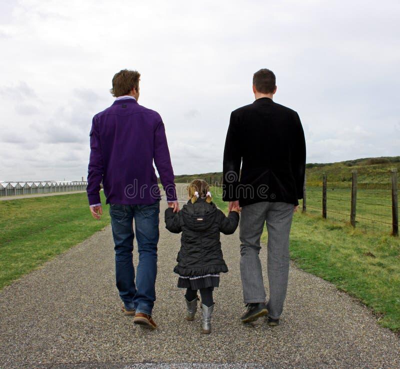 Pares masculinos com criança imagem de stock royalty free