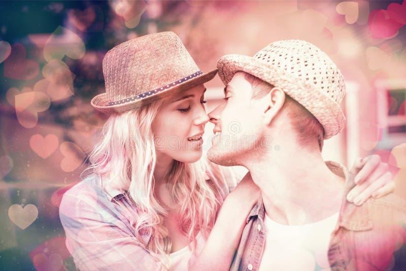 Pares novos ancas aproximadamente a beijar ilustração do vetor