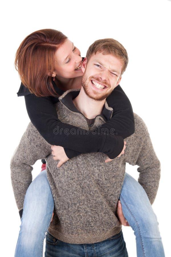 Pares novos felizes - mulher que morde lovingly o homem fotografia de stock