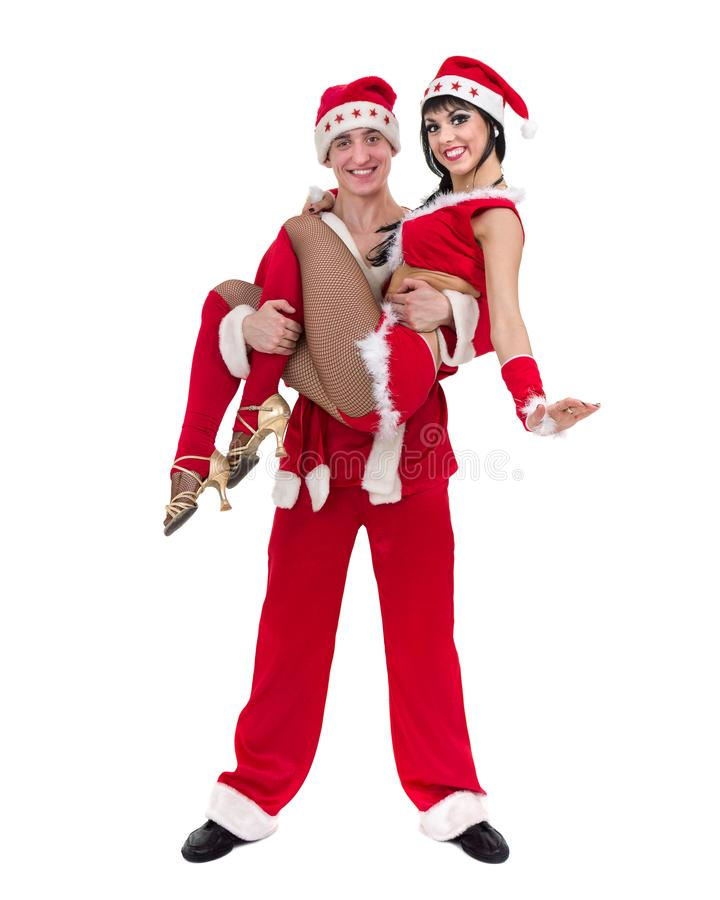 Pares novos felizes que desgastam a roupa de Papai Noel imagem de stock royalty free