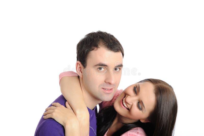Pares novos no amor que tem o divertimento. isolado imagem de stock