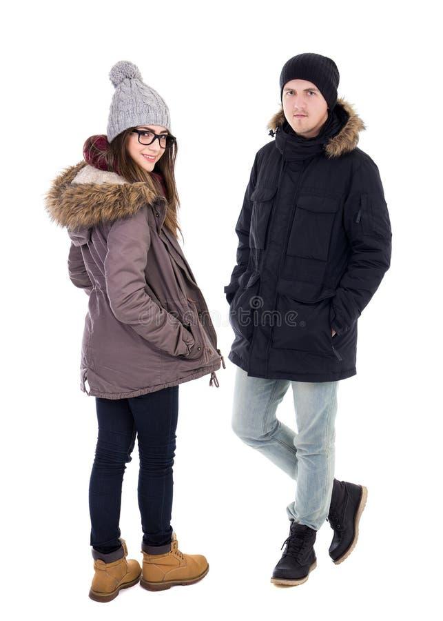 Pares novos nos revestimentos do inverno isolados no branco fotografia de stock royalty free