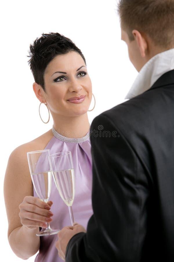 Pares que clinking com champanhe foto de stock royalty free
