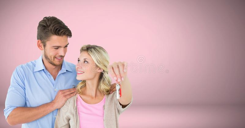 Pares que se sostienen dominantes delante de la ilustración foto de archivo libre de regalías