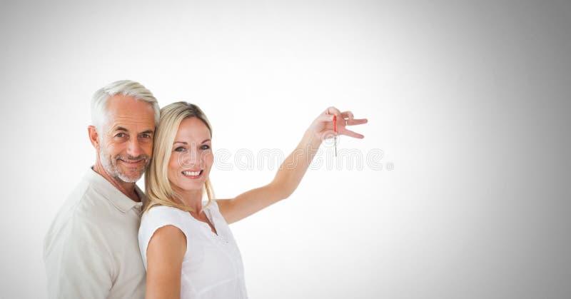 Pares que se sostienen dominantes delante de la ilustración fotos de archivo