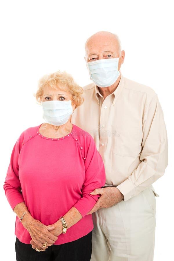 Pares sênior - proteção da gripe fotos de stock