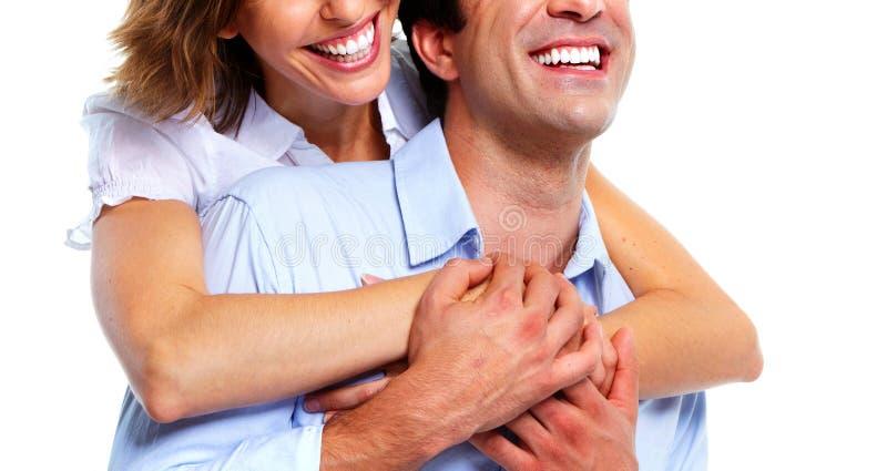 Pares sonrientes jovenes imagen de archivo libre de regalías
