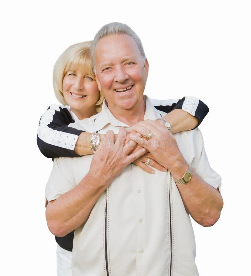 Pares superiores atrativos felizes que abraçam no fundo branco fotografia de stock