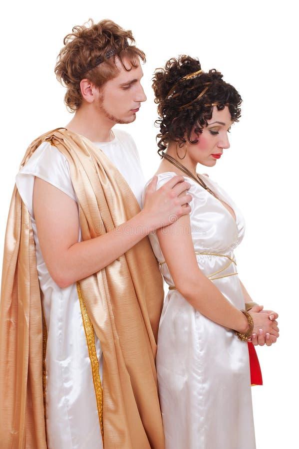 Pares tristes no estilo grego imagens de stock royalty free