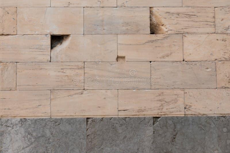 Parete antica nociva del marmo del blocco a Atene immagine stock