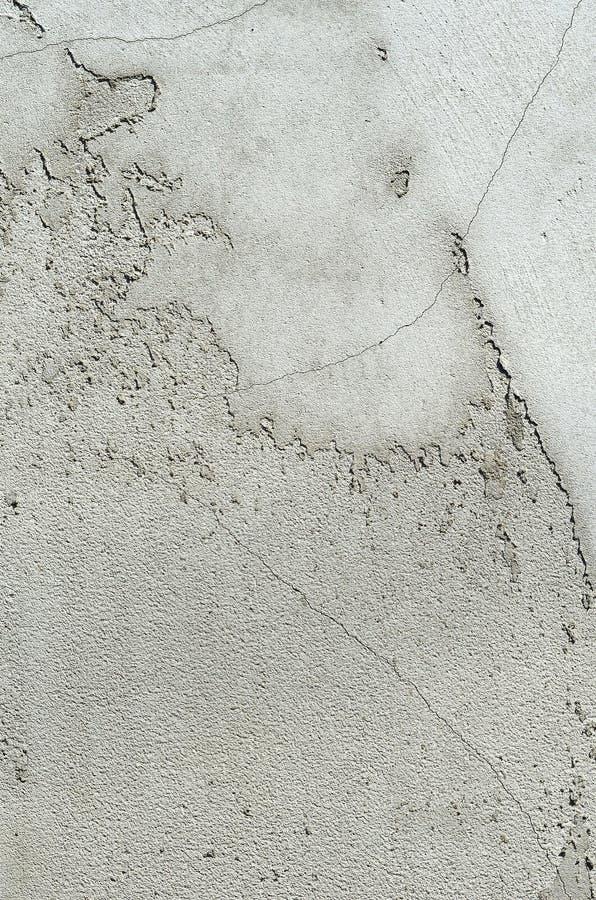 Parete bianca dello stucco Struttura dipinta grungy grigia della parete del cemento fotografie stock libere da diritti
