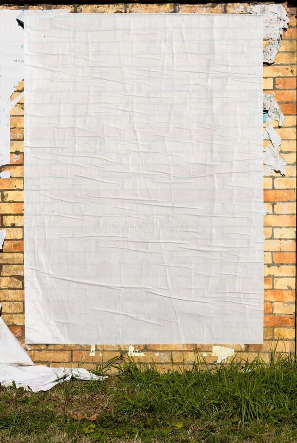 Parete con il manifesto in bianco immagini stock libere da diritti