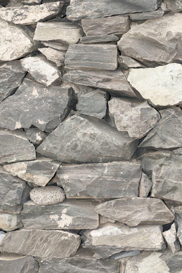 Parete con le strutture di pietra nel grey fotografia stock
