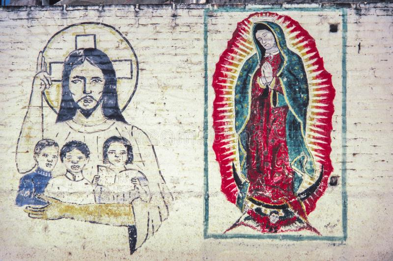 Parete con religioso assorbendo le vie del Messico fotografie stock libere da diritti