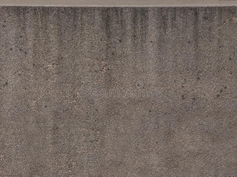 Parete concreta del cemento di lerciume Struttura grigia senza cuciture del muro di cemento del primo piano fotografia stock
