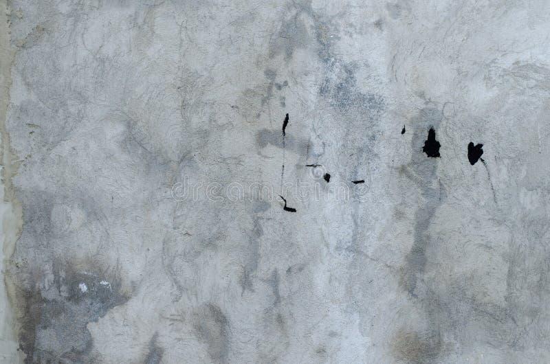 Parete concreta grigia del garage con i punti del BAC nero dell'estratto della pittura fotografia stock libera da diritti