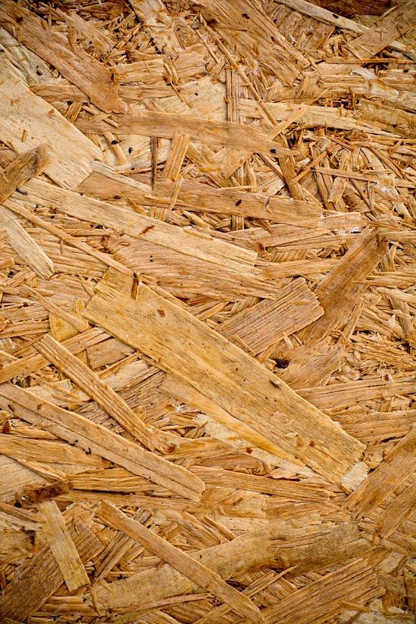 Parete dei fiocchi di legno in pieno di struttura e del modello casuale immagine stock