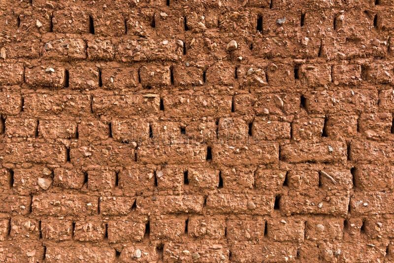 Parete dei mattoni del fango fotografia stock