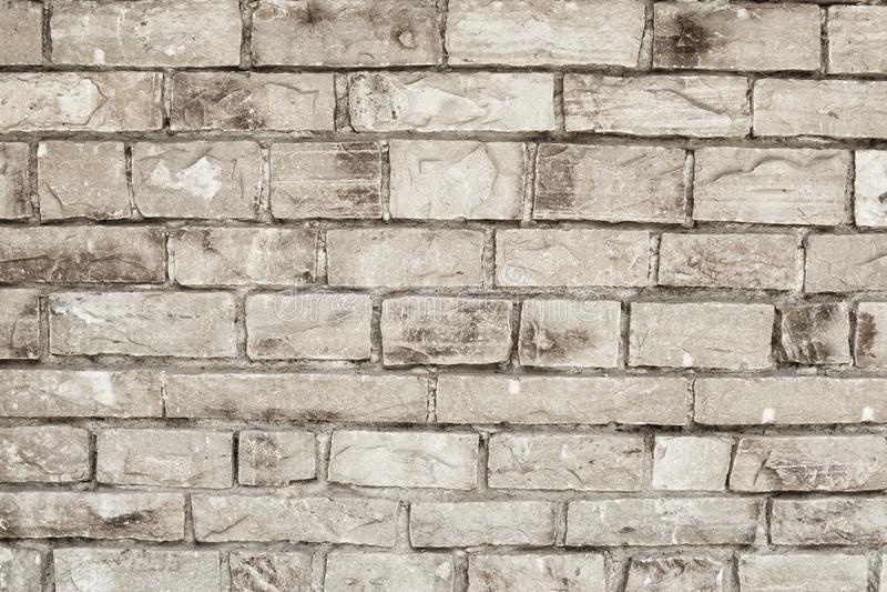 Parete dei mattoni grigi di pietra, fondo astratto Costruzione del muro di mattoni fotografia stock libera da diritti