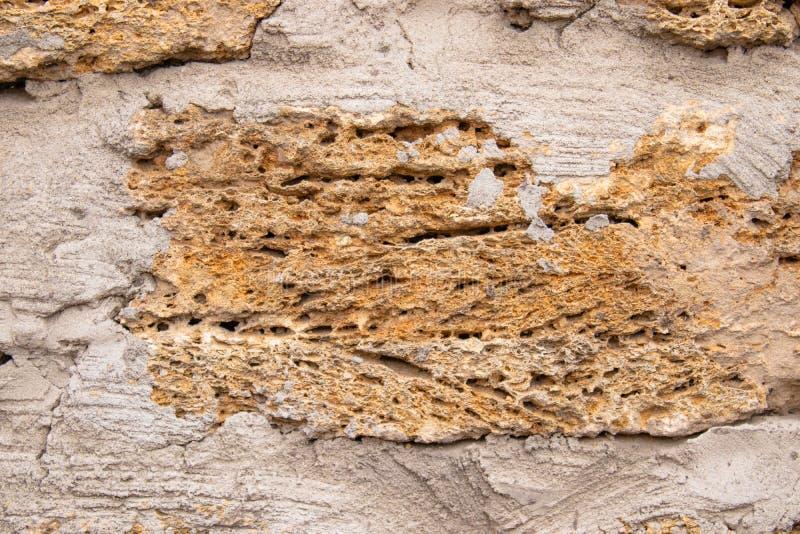 Parete del fondo con la roccia delle coperture Vecchia parete Calcare di struttura immagini stock