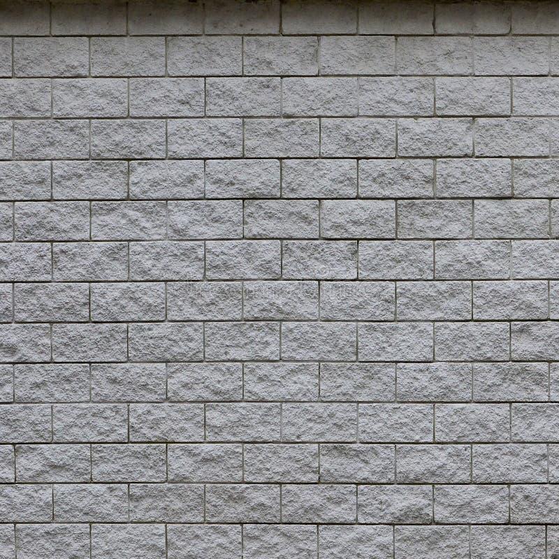 Parete delle mattonelle leggere di struttura, stilizzata nell'aspetto come mattone Uno dei tipi di decoratio della parete fotografia stock