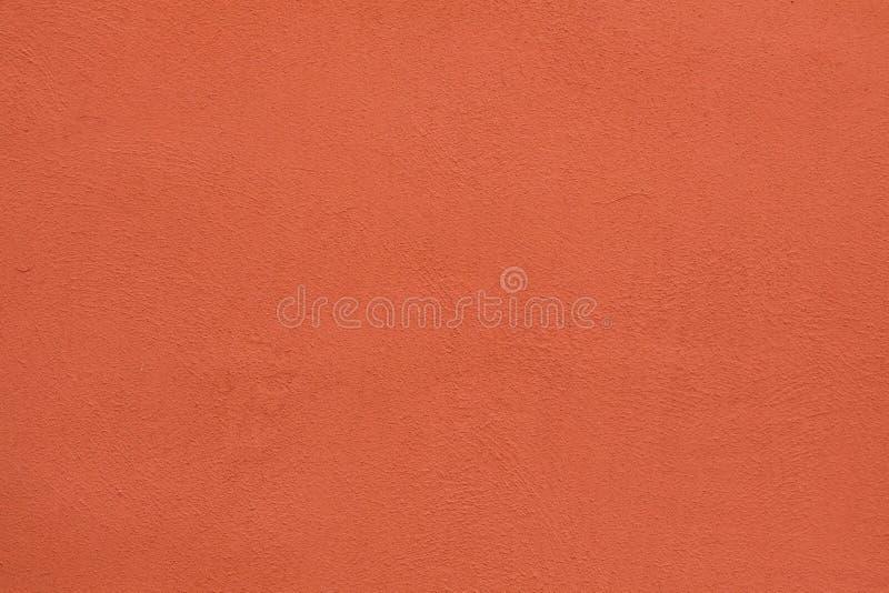 Parete dello stucco dipinta arancia Struttura della priorità bassa immagine stock