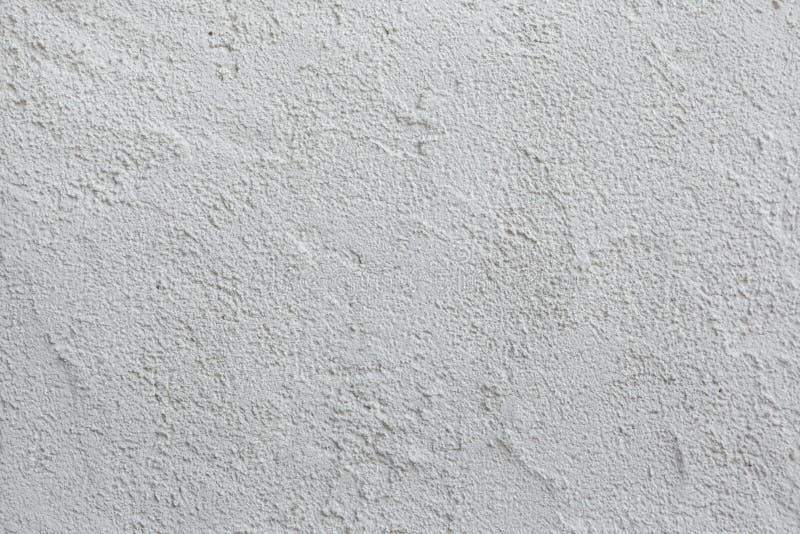 Parete dello stucco dipinta bianco Struttura della priorità bassa immagini stock