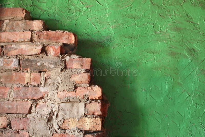 Parete dello stucco e del mattone immagini stock