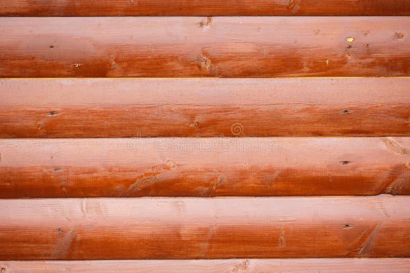Parete di Brown dei ceppi di legno fotografie stock
