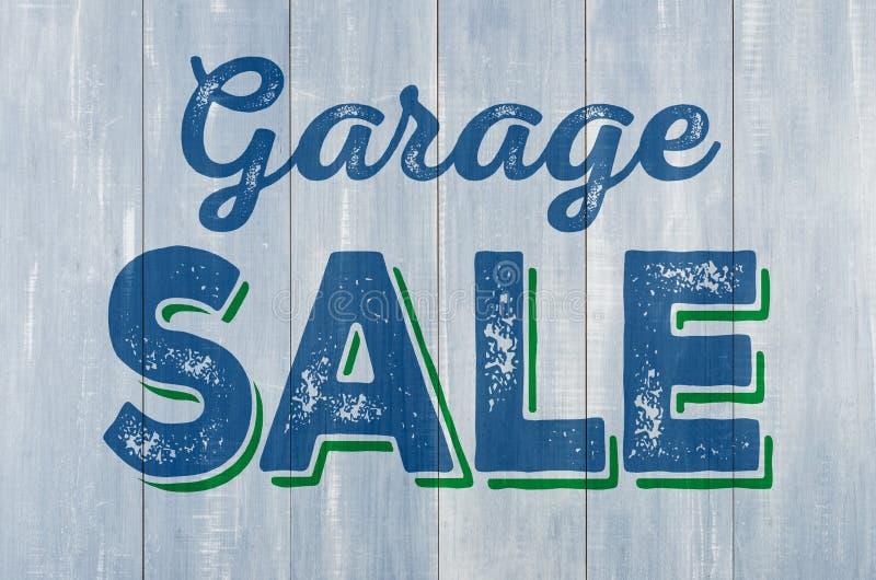 Parete di legno con la vendita di garage dell'iscrizione fotografie stock