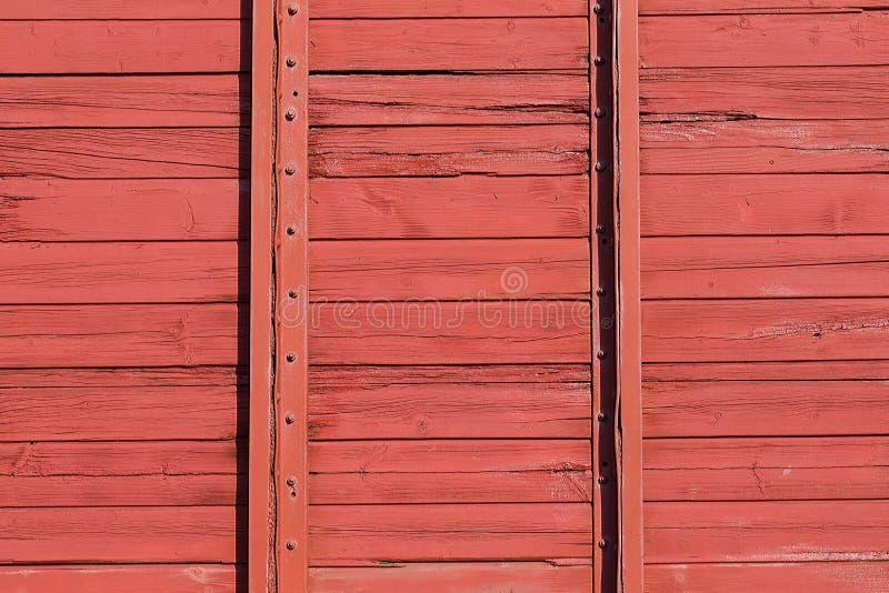 Parete di legno rossa del vagone della ferrovia Reticolo della priorità bassa fotografia stock