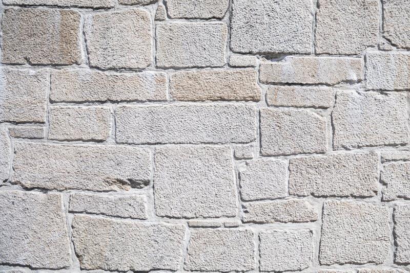 Parete di pietra artificiale bianca fotografie stock