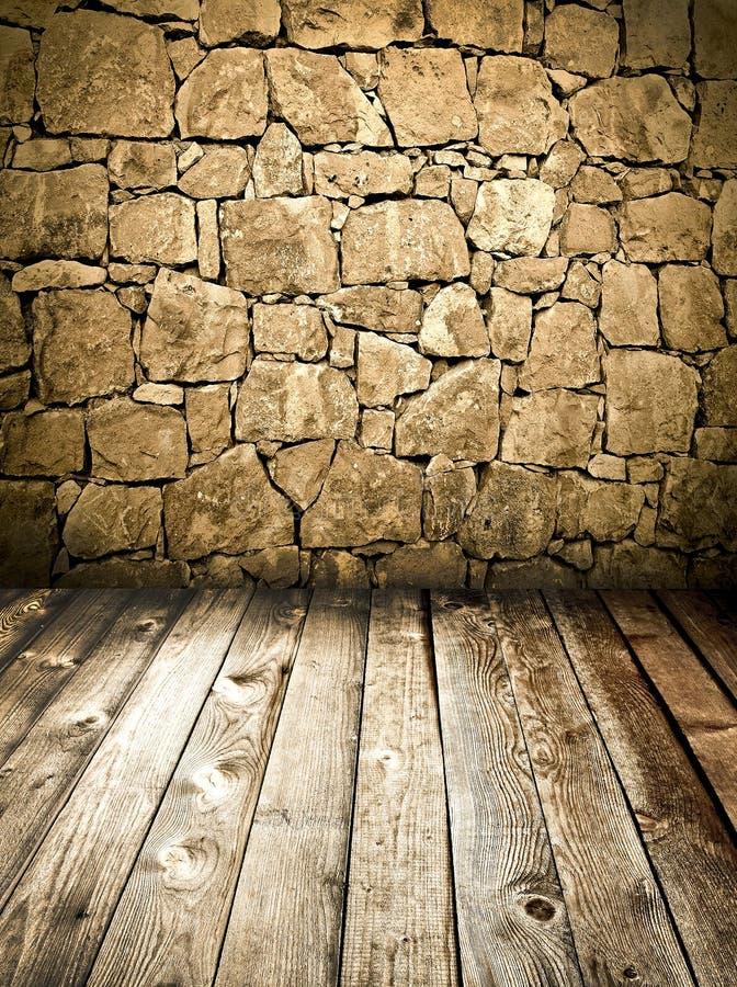 Parete di pietra e pavimento di legno fotografia stock - Parete di pietra ...