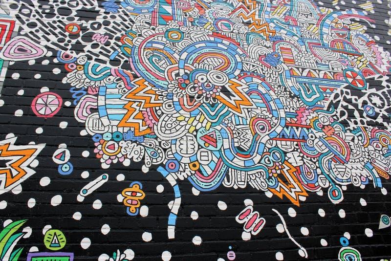 Parete esterna lunga di costruzione con l'arte della via dipinta attraverso superficie, Austin del centro, il Texas, 2018 royalty illustrazione gratis