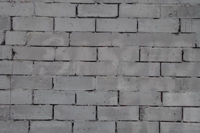 Parete fatta delle unità concrete grige della muratura fotografia stock