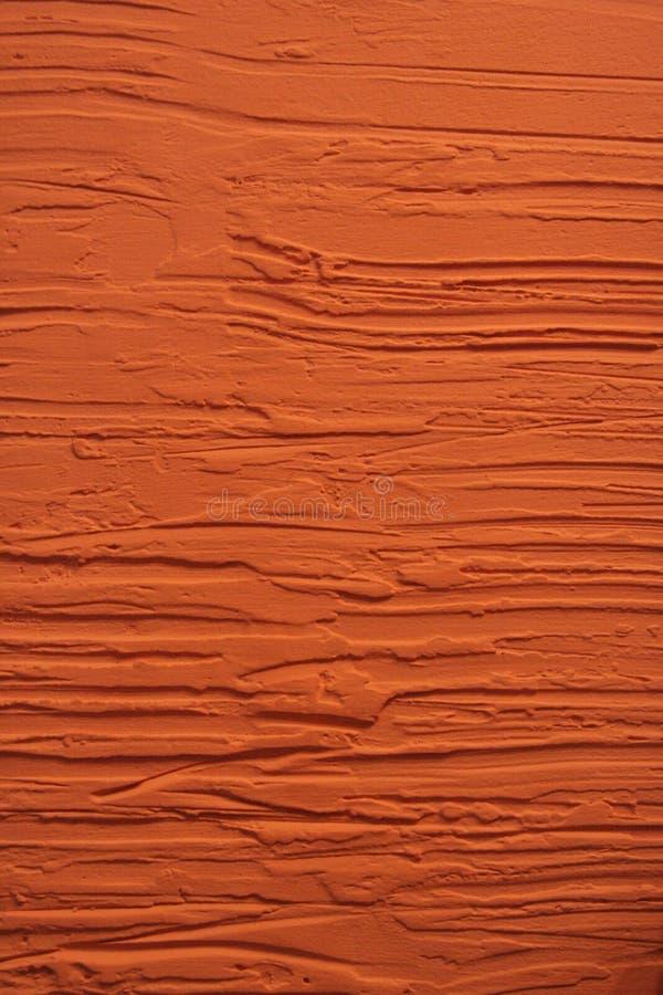 Parete intonacante arancio immagini stock libere da diritti