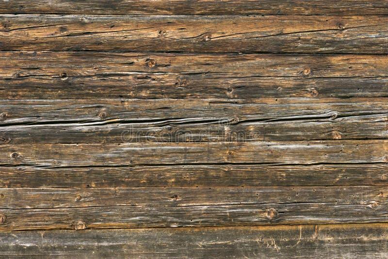 Parete marrone naturale di legno del granaio Modello del fondo di struttura della parete immagini stock libere da diritti