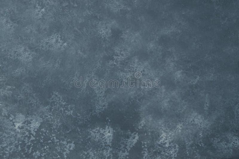 Parete strutturata di lerciume grigio Fondo di pietra scuro fotografia stock