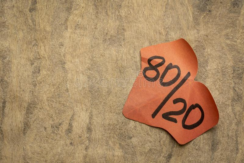 Pareto principle or eighty-twenty rule. Leaf shaped sticky note against textured paper - a reminder or advice royalty free stock photos