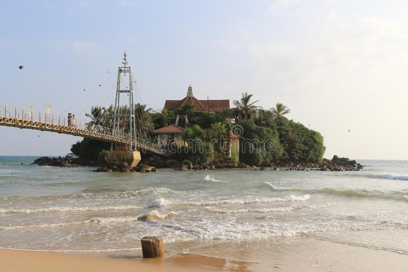 Parey Dewa Rock in Water or Paravi Dupatha,  Buddha temple in front of  Matara city, Sri Lanka royalty free stock image