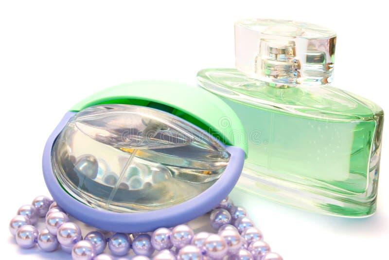 Parfum en halsband stock foto