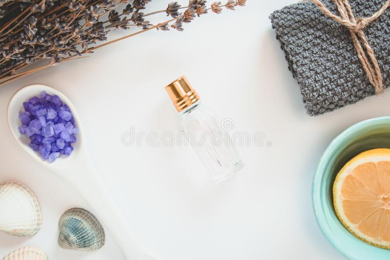 Parfume, flowers of lavender, lemon, terry towel, sea salts, seastones and seashells on the white background stock image