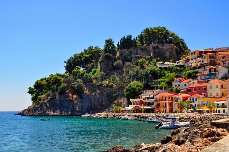 Parga, Epirus - Greece. Colorful houses amphitheatrically built next to the castle of Parga. Sunny day with clear blue sky royalty free stock image